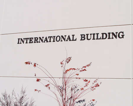 International building sign on the side of a white building Zdjęcie Seryjne