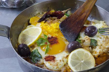 huevos estrellados: fried eggs with onions, celery, sour tomato