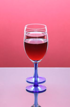 Two Full Wine Glasses with Focus on Closest Glass with Copy Space