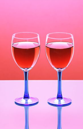 two glasses of red wine  against a colorful background Stock Photo