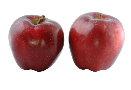 Two ripe red apples on a light background