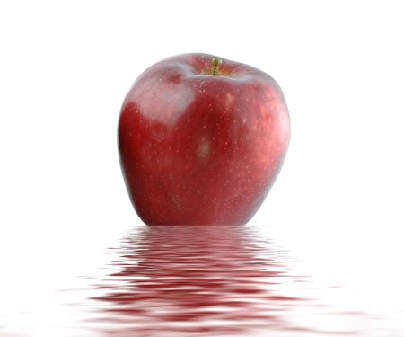 Wet juicy red  apple over water. Isolated