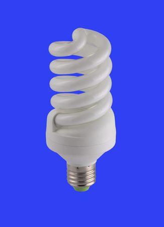 Energy-saving lamp isolated on blue background