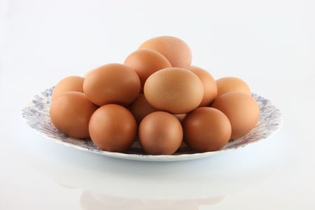 Eggs in a bowl on a white background Stock Photo