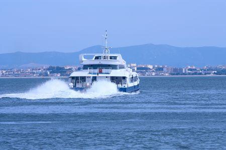 Big passenger ship leaving harbor