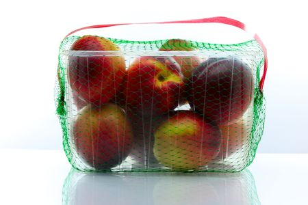 peaches packed in a plastic container Stock Photo - 5230240