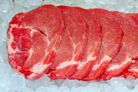 fresh pork on board ready to cook ice storage Stock Photo