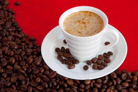 expressed: cup with coffee and grain expressed on red background