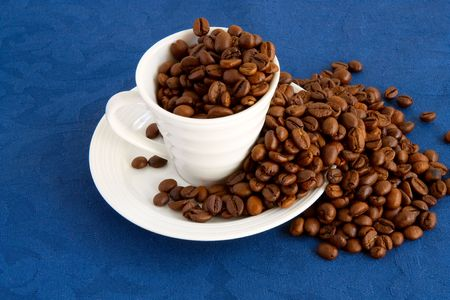 expressed: cup with coffee and grain expressed on blue background