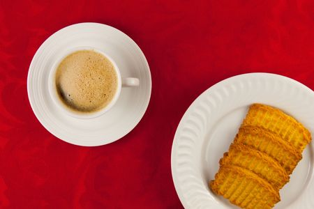 Coffee and cookies on a red background
