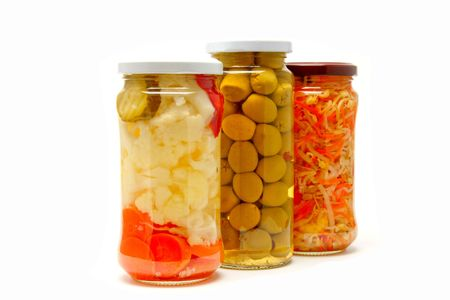 cymbling: Glass jars with marinated vegetables  isolated on the white background