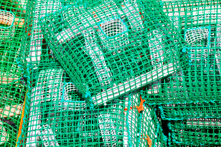 Lobster pots and crab pots drying in the sun on the pier, Cascais, Portugal
