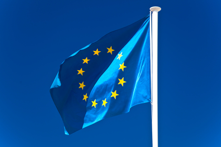 flagstaff: European Union flag flying in front of bright blue sky