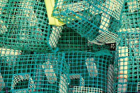 Lobster or crab pots stacked on jetty
