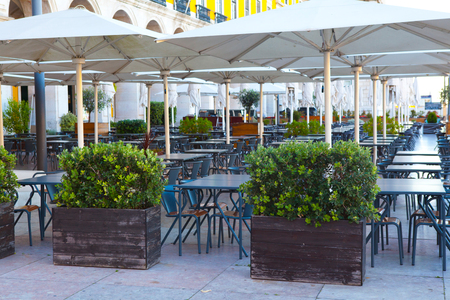 Outdoor street cafe tables in Lisbon Stock Photo