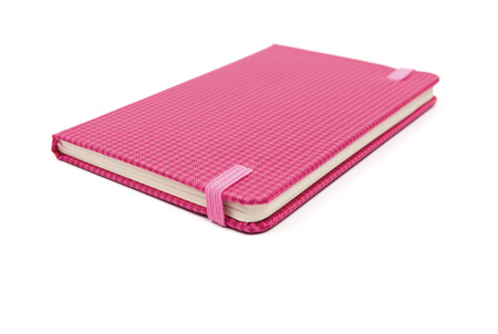 A pink notebook isolated on white background