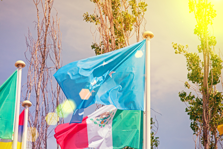 Flags  on the background of the blue sky in the sunlight
