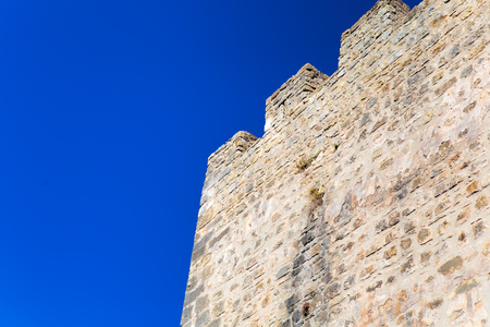 Stone wall and blue sky , background Stock Photo