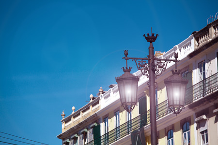 Old street lamp on a classical facade in Lisbon