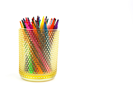Group of color felt-tipped pens in a glass, white background Stock Photo