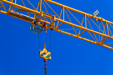 Part construction crane with blue sky background