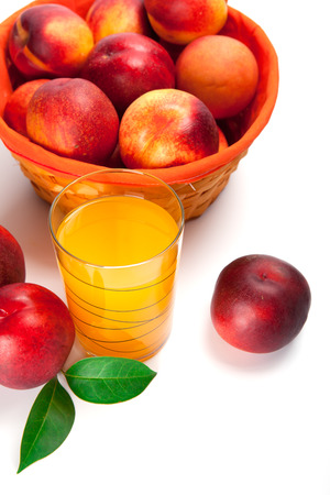 Peach fruit juice in glass isolated on white background Stock Photo