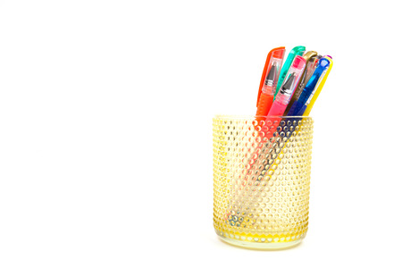 colorful pens in a cup, isolated on white Stock Photo