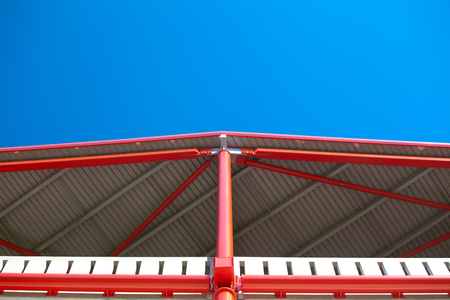 Roof steel construction of a stadium against blue sky Stock Photo
