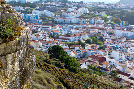 View on Nazare beach  on the coast of Atlantic ocean . Portugal .