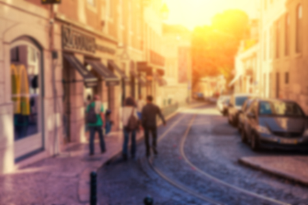 Street in the historical city center at sunset time. Blurred  image.
