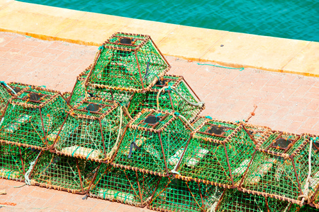 Lobster pots and crab pots drying in the sun on the pier