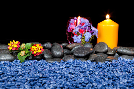 Spa decoration with stones and candles  on a black background Stock Photo