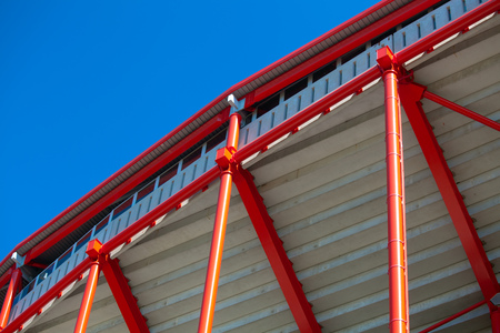 red metal structure on a background of blue sky