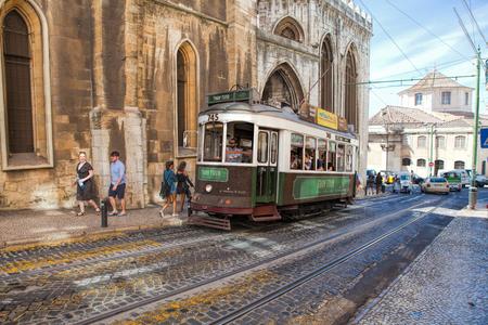 LISBON, PORTUGAL - SEPTEMBER 14 . 2017 . Vintage tram in the city center of Lisbon Lisbon, Portugal in a summer day Editoriali