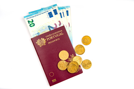 The Portuguese passport and euro banknotes . isolated on white background