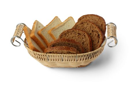 Sliced bread in a wicker basket on a white background photo