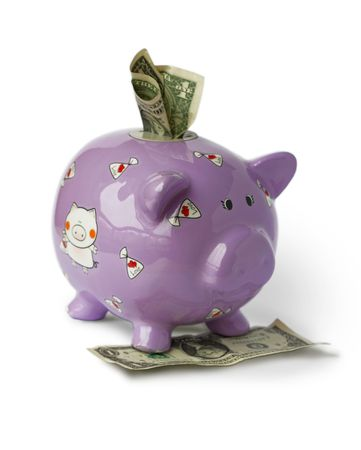 Piggy moneybox with money on the white background photo