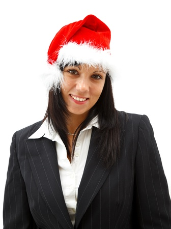 Attractive smiling businesswoman in santa hat photo