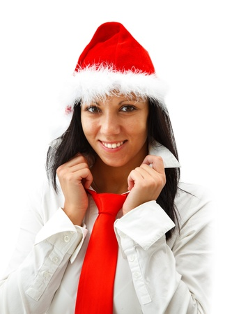 Attractive smiling woman in santa hat wearing a red tie photo