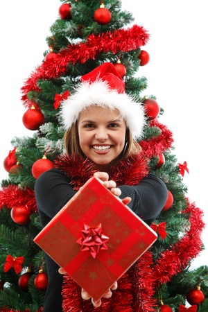 Young attractive woman with a gift near the Christmas tree   Stock Photo - 8460403