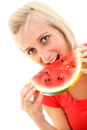 An attractive young girl eating a slice of watermelon Stock Photo - 8479971