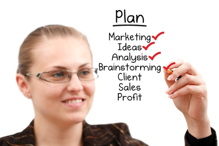 A young attractive businesswoman drawing a plan isolated over a white background Stock Photo - 8480008
