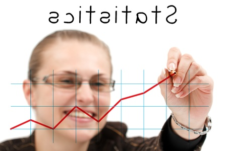A young attractive businesswoman drawing a statistics isolated over a white background Stock Photo - 8480007