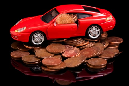 A red car on the cooper coins Stock Photo - 9492904