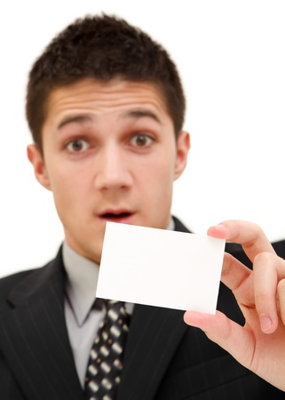 Surprised young businessman with a white card Stock Photo - 9493194