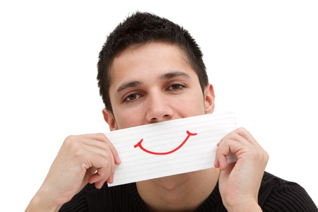 A handsome young man holding a ruled paper with a red smile on it Stock Photo - 9493065