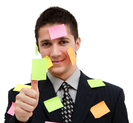 A handsome young businessman with plenty of post-it Stock Photo - 9493235