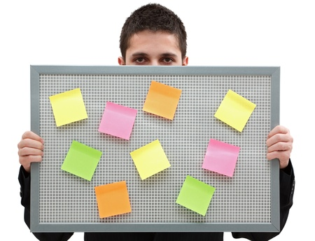 A businessman holding a reminder board with plenty of colorful post-it on it Stock Photo - 9493045