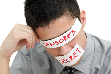 censure: Young businessman with a band on his eyes and mouth Stock Photo