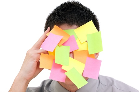 yelloow: Businessman with plenty of colorful post-it on his face